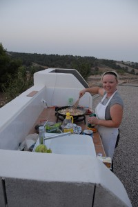 Debs cooking lunch in our outdoor kitchen