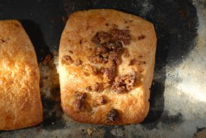 Sweet bread, with savoury meat on top (crunchy) - sweet and savoury mix!
